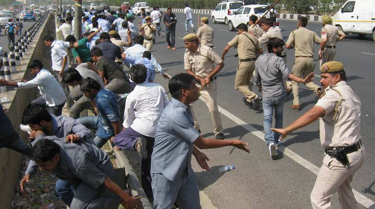 Gurgaon: Police lathicharge agitating taxi drivers during their protest over ban on diesel vehicles, at Delhi-Gurgaon Expressway in Gurgaon on Monday. PTI Photo (PTI5_2_2016_000141B)