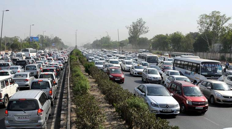 Gurgaon: Heavy traffic jam during protest of diesel taxi drivers and owners who jammed the Delhi- Gurgaon expressway at border near Rajokri flyover in protest the ban of diesel taxi in National Capital on Monday. PTI Photo (PTI5_2_2016_000275a)