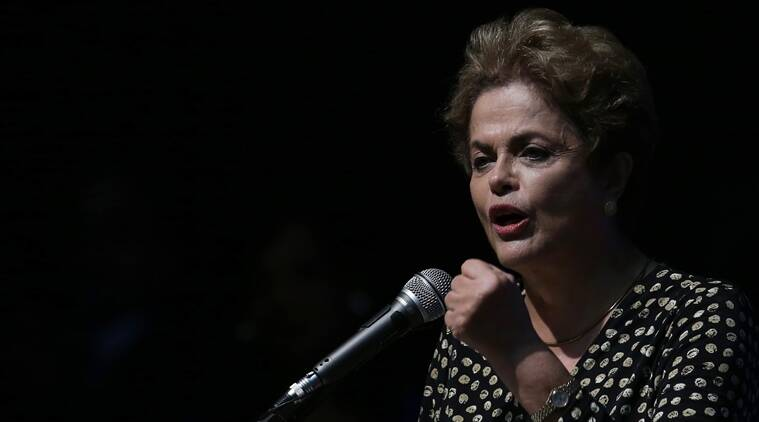 Brazil's President Dilma Rousseff speaks during the opening of the National Conference of Women, in Brasilia, Brazil, Tuesday, May 10, 2016. The impeachment proceedings against Rousseff took another hairpin turn Tuesday after the acting speaker of Congress' lower house Waldir Maranhao put the impeachment process back on track a day after he sparked chaos and sowed further discord among Brazil's fractious political class by annulling an April 17 vote by the Chamber of Deputies for impeachment. (AP Photo/Eraldo Peres)