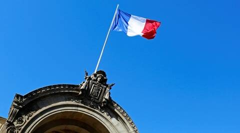 The French flag is pictured at the Elysee Palace following the weekly cabinet meeting in Paris