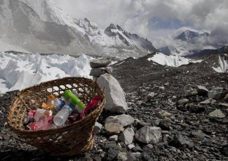 Rubbish collected at Everest base camp with the Himalayan range seen at the background in Nepal, May 03, 2011. REUTERS/Laurence Tan/Files