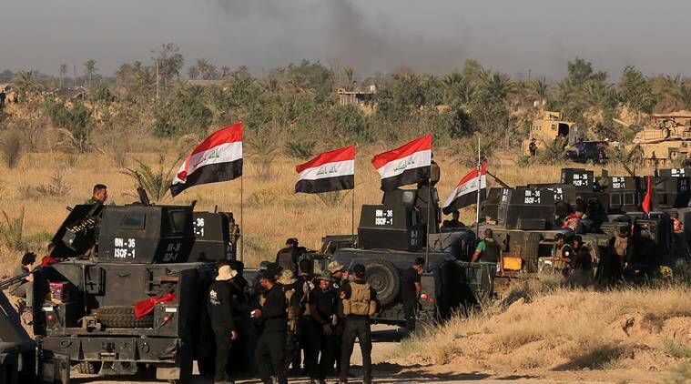 Fallujah: Iraqi forces fight IS attack in city's south