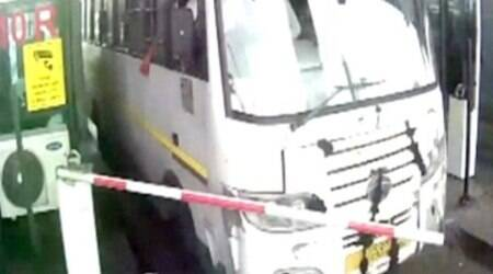 Bus driver refuses to pay toll, rams through gate inGurgaon