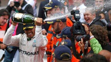 Lewis Hamilton ends race drought in Monaco's rain
