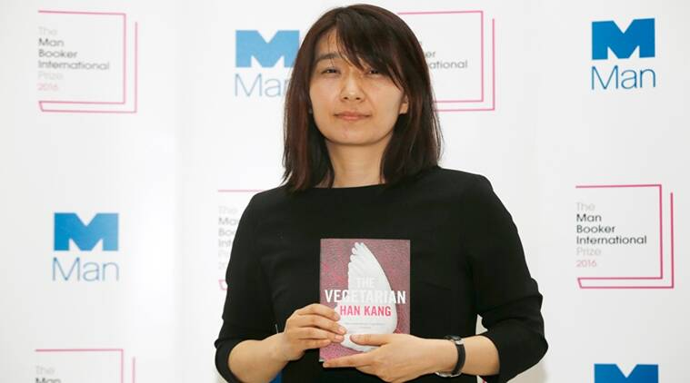 Winner of the 2016 Man Booker International prize for fiction Han Kang poses for the media with her book 'The Vegetarian' following the award ceremony in London, Monday, May, 16, 2016. (AP Photo/Alastair Grant)