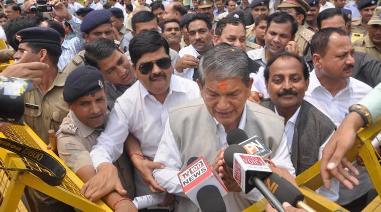Dehradun : Former Chief Minister Harish Rawat talks to the media after the end of crucial Uttarakhand Assembly floor test, at party office in Dehradun on Tuesday. PTI Photo (PTI5_10_2016_000187A)