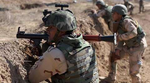 "FILE - In this March 21, 2015 file photo, Iraqi security forces participate in a drill as U.S. forces train them in Taji, north of Baghdad, Iraq. No one disputes that U.S. military forces are fighting in combat in Iraq and Syria -- except maybe President Barack Obama and some members of his administration. The semantic arguments over whether there are American ""boots on the ground"" muddy the view of a situation in which several thousand armed U.S. military personnel are in Iraq and Syria.  (AP Photo/Karim Kadim, File)"