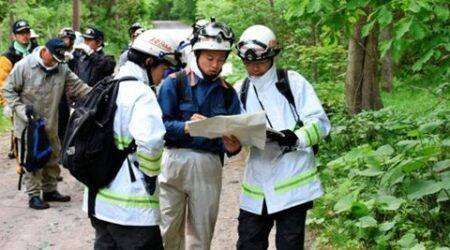 Japan rescuers expand forest search for missing boy