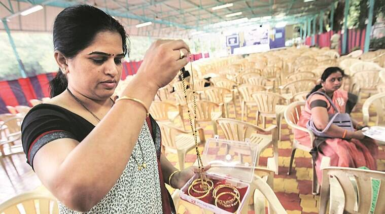 Sunita Patil, a resident Pashan, recieved her stolen jewelry backs on Wednesday three months after they were allegedly stolen by burglars from her house. The police handed over jewelry worth Rs 78.21 lakh to citizens who had lost them to miscreants. Express Photo by Sandeep Daundkar,Pune,11.05.2016
