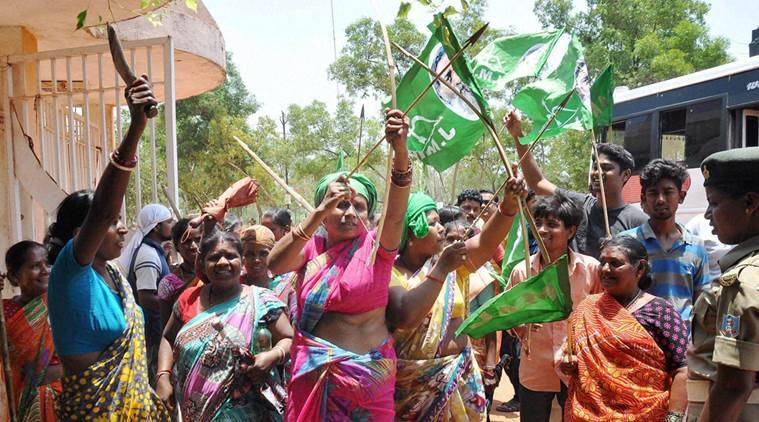 Ranchi: JMM supporters shout slogans holding bows and arrows during the Jharkhand bandh called by opposition parties to protest the Jharkhand government's domicile policy, in Ranchi on Saturday. PTI Photo(PTI5_14_2016_000066B)