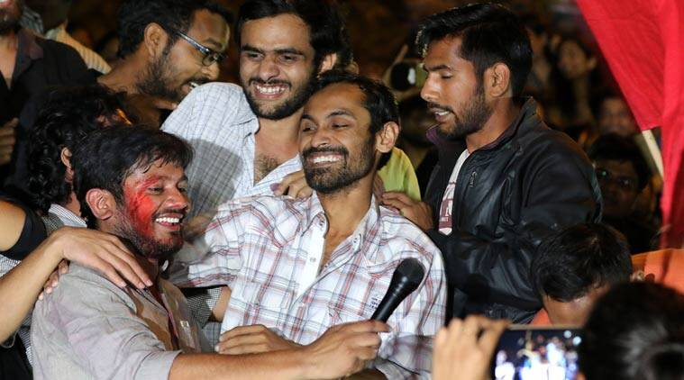 Umar Khalid and Anirban Bhattacharya with JNUSU president Kanhaiya Kumar at JNU campus, after released from Tihar jail, in Delhi on March 18th 2016. Express photo by Ravi Kanojia.