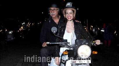 Waiting actors Naseeruddin Shah, Kalki Koechlin go for a bike ride