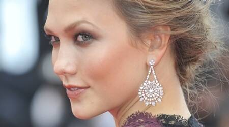 Karlie Kloss, celebrity beauty secrets, curling eyelashes, eye puffiness