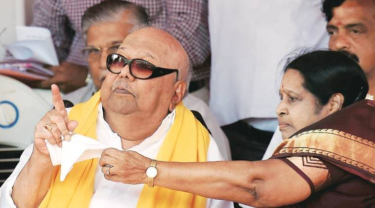 M Karunanidhi with his wife Rajathi Ammal during a campaign in Chennai. (Source: PTI)