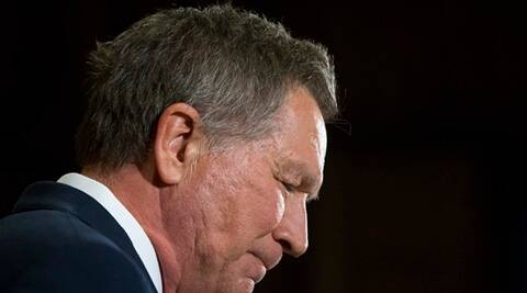 Republican presidential candidate Ohio Gov. John Kasich pauses to read his notes as he speaks at The Franklin Park Conservatory & Botanical Gardens, Wednesday, May 4, 2016, in Columbus. Ohio. Kasich announced the end of his White House bid. (AP Photo/John Minchillo)