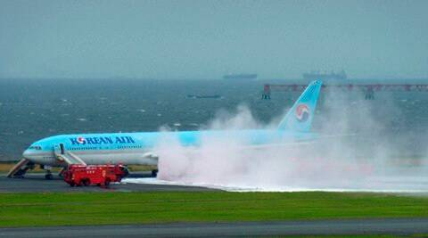 Tokyo : White smoke rises from an engine of a Korean Air jet as firefighters battle an apparent engine fire on the tarmac at Haneda Airport in Tokyo Friday, May 27, 2016 . All the passengers and crew were evacuated unharmed, Japanese media reported. AP/PTI(AP5_27_2016_000010B)