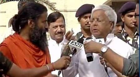 Face to face, Lalu forgets old criticism, gets a facial from BabaRamdev