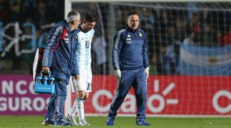 Messi worries Argentina with back injury in 1-0 win