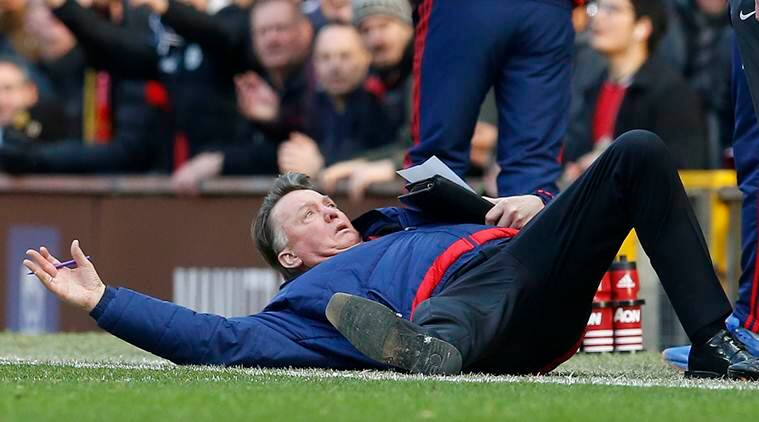 "Football Soccer - Manchester United v Arsenal - Barclays Premier League - Old Trafford - 28/2/16 Manchester United manager Louis van Gaal lies on the side of the pitch to demonstrate a foul to the fourth official Mike Dean Reuters / Phil Noble Livepic EDITORIAL USE ONLY. No use with unauthorized audio, video, data, fixture lists, club/league logos or ""live"" services. Online in-match use limited to 45 images, no video emulation. No use in betting, games or single club/league/player publications. Please contact your account representative for further details."