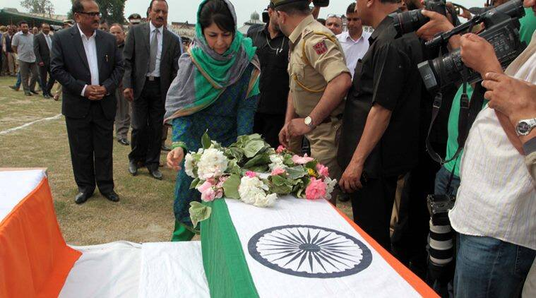 Cheif Minister of J&K Mahbooba Mufti lays wreath on the coffins of the policemen at control room Srinagar. Unidentified gunmen shot dead two policemen at Zadibal in Srinagar. This is the first such major strike in the city in nearly three years. In the second incident, the suspected militants shot dead another policeman at Tengpora Batamaloo, Srinagarl. Express Photo by Shuaib Masoodi 23-05-2016