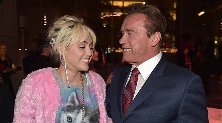 Arnold Schwarzenegger, Miley Cyrus reunite after she broke up with