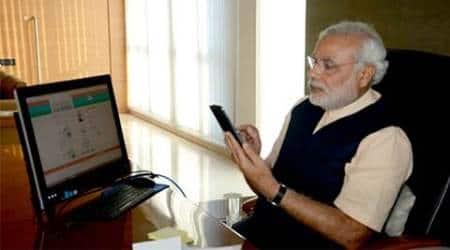 Modi, modi twitter, modi facebook, modi govt anniversary, mea twitter, sushma swaraj twitter, suresh prabhu twitter, indian railways twitter, modi twitter account, modi social media, modi twitter followers,