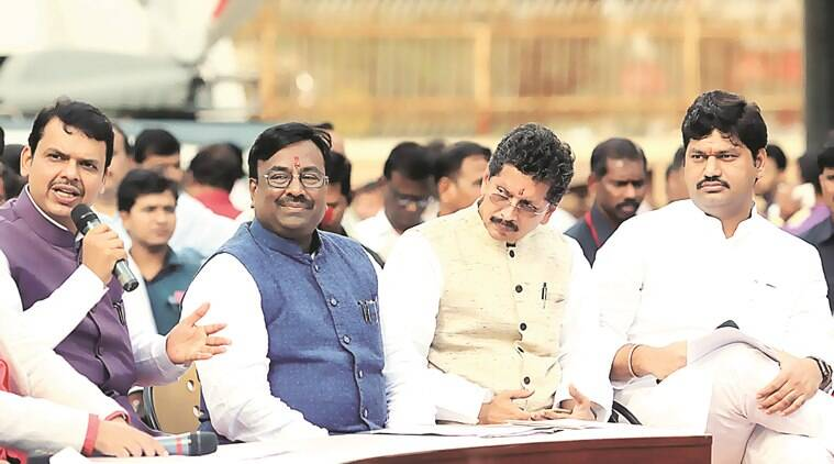Sudhir Mungantiwar (C), state Finance minister with chief minister Devendra Fadnavis (L) and Deepak Kesarkar and Dhananjay Munde during assembly session at Vidhan Bhavan in Mumbai on Thursday. Express Photo By Ganesh Shirsekar 18/03/2016