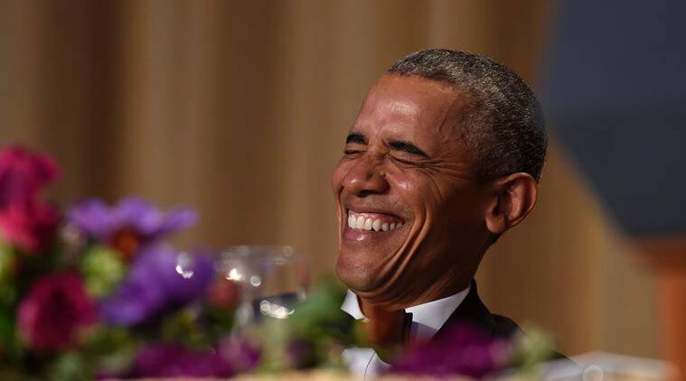 President Barack Obama laughs as he listens to Larry Wilmore, the guest host from Comedy Central, speak at the annual White House Correspondents' Association dinner at the Washington Hilton in Washington, Saturday, April 30, 2016. (AP Photo/Susan Walsh)