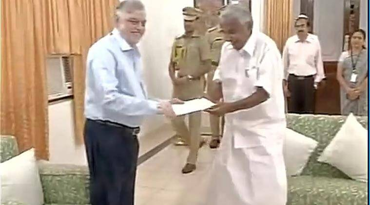 Chandy drove to the Raj Bhavan around 10.30 am and submitted his resignation letter to Governor P Sathasivam. (Source: ANI photo)