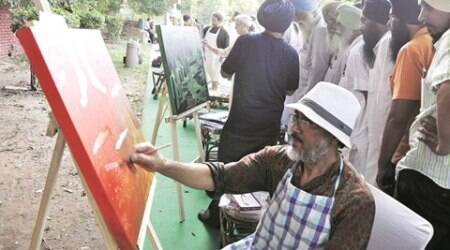 Artistes during a painting workshop on Farm Crisis at Sukhna Lake in Chandigarh on Sunday, May 29 2016. Express Photo by Sahil Walia