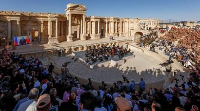 People, including Russian servicemen, attend a concert of Mariinsky Theatre in the amphitheatre of the Syrian city of Palmyra, Syria, in this handout photo released by Russian Ministry of Defence on May 6, 2016. Olga Balashova/Russian Ministry of Defence/Handout via Reuters  ATTENTION EDITORS - THIS IMAGE WAS PROVIDED BY A THIRD PARTY. EDITORIAL USE ONLY. NO RESALES. NO ARCHIVE.