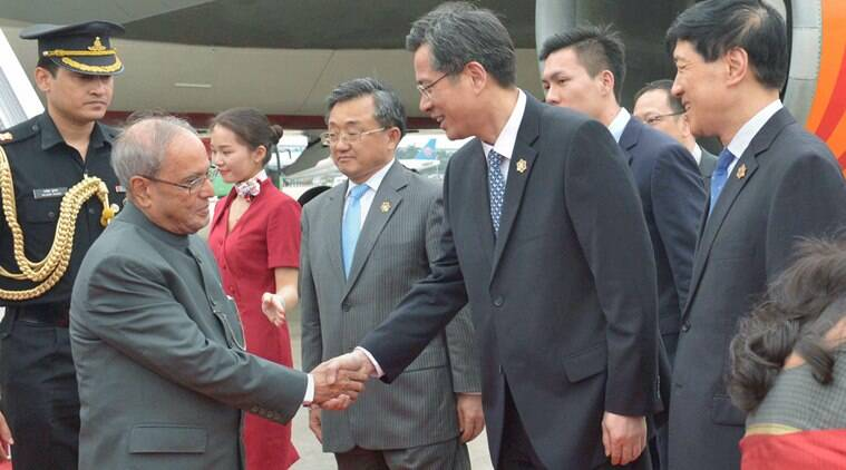 Guangzhou : President Pranab Mukherjee is received by Vice Governor of Guangdong Mr. He Zhongyou as China's Foreign Affairs Vice Minister Liu Zhenmin looks on, upon his arrival at Guangzhou in China on Tuesday. PTI Photo (PTI5_24_2016_000140B)