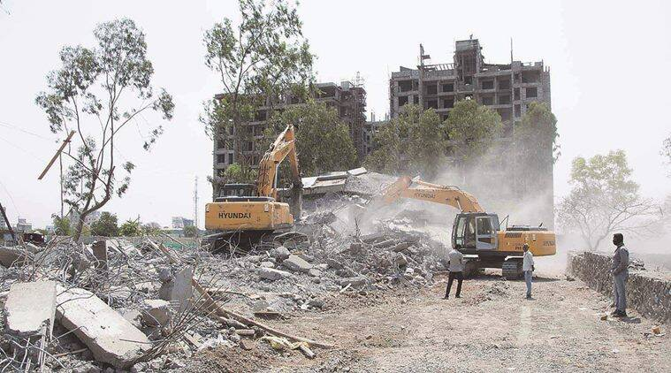 PMRDA, building demolition, illegal construction, pune illegal construction, undri, pune news, indian express pune