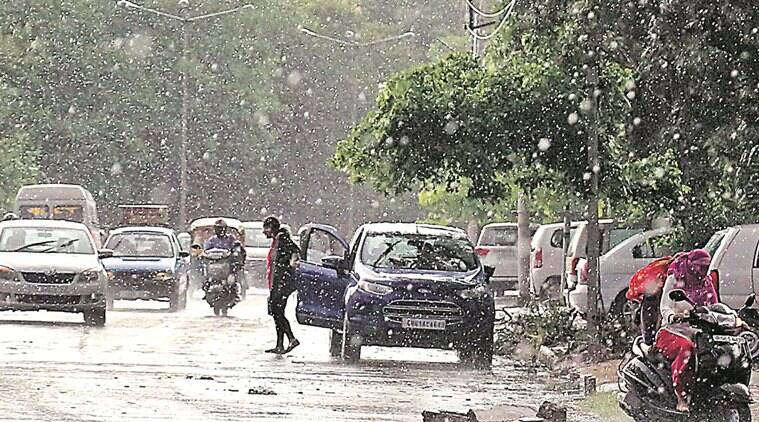 Commuters during rain after heavy dust storm in Chandigarh on Friday, May 20 2016. Express Photo by Kamleshwar Singh