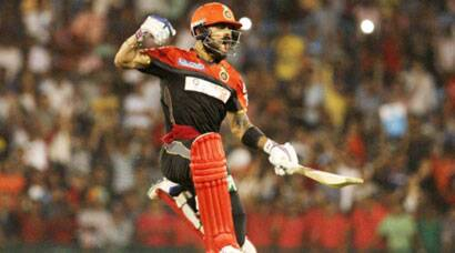Virat Kohli scores fifty as RCB beat DD, reach play-offs