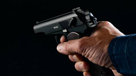 PM makarov Gun in man hand on black background