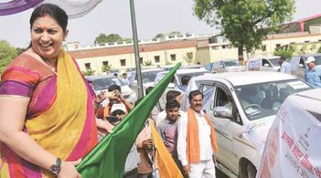 Amethi: HRD Minister Smriti Irani flags off a campaign to aware people about Pradhan Mantri Kaushal Vikas Yojana (PMKVY) in Amethi on Thursday. PTI Photo   (PTI5_26_2016_000159A)