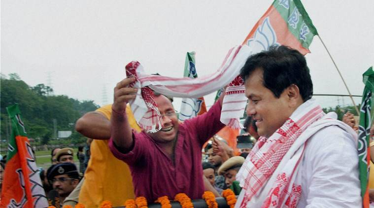 Guwahati: BJP chief ministerial candidate Sarbananda Sonowal at a victory procession after the party's thumping win the Assam Assembly polls, in Guwahati on Thursday. PTI Photo (PTI5_19_2016_000302B)