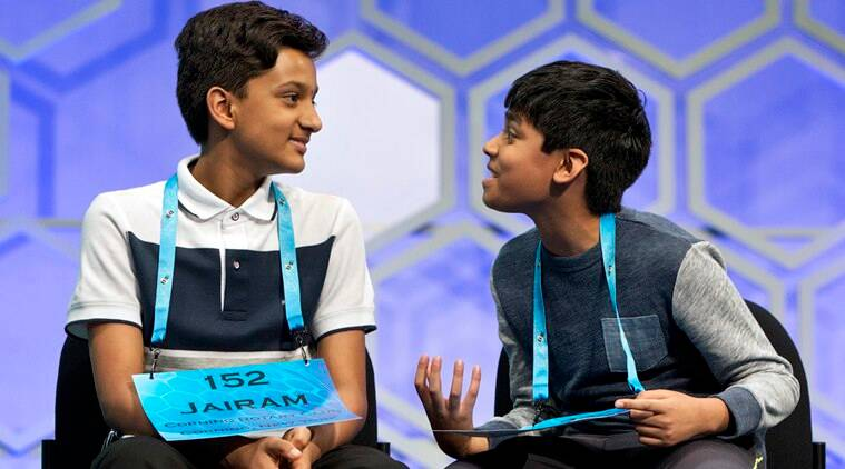 Nihar Janga, 11, of Austin, Texas, right, talks with Jairam Hathwar, 13, of Painted Post, N.Y., left, after another round where the two went head to head in a drawn out battle that ended in them being named co-champions in the 2016 National Spelling Bee, in National Harbor, Md., on Thursday, May 26, 2016. (AP Photo/Jacquelyn Martin)