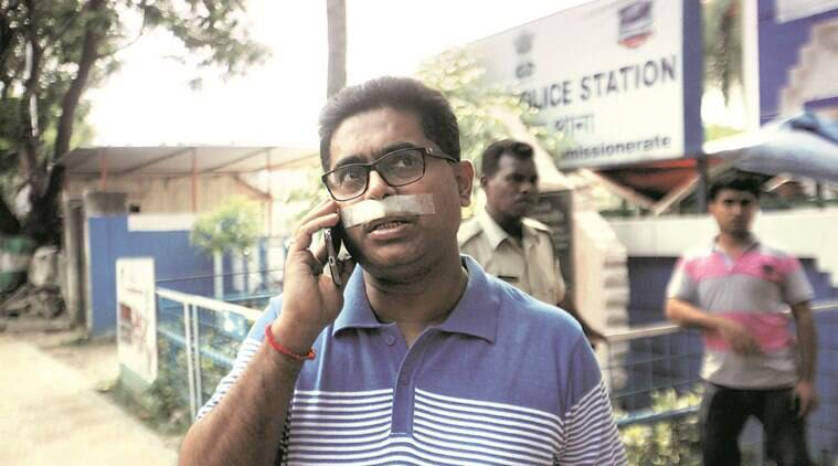 Triguna Roy, Officer incharge of Lake Town police station who was injured during a clash at Dakshindari near Lake Town last night. Infront of Lake Town PS on Tuesday. Express photo by Subham Dutta. 10.05.16