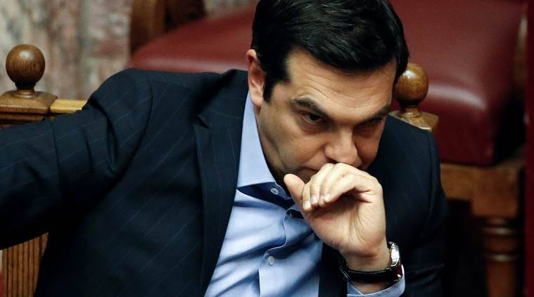 Greek Prime Minister Alexis Tsipras attends a parliamentary session before a vote of tax and pension reforms in Athens, Greece, May 8, 2016. REUTERS/Alkis Konstantinidis     TPX IMAGES OF THE DAY