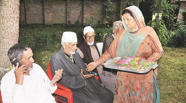 Family of Athar Khan, rank 2, celebrates in Anantnag on Tuesday. PTI photo