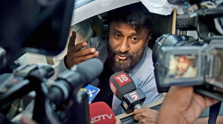 Film director Vivek Agnihotri interacts with the media after his car was stopped by the students at the entrance of Jadavpur University campus for screening of his film 'Buddha in a Traffic Jam' in Kolkata on Friday. PTI