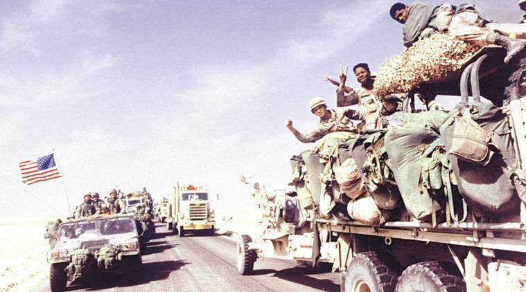 Subject: US soldiers raising veed fingers fr. passing truck as convoy moves into Iraq in US-led allied OP Desert Storm Gulf war against Iraqi occupiers of Kuwait. February 24, 1991 Photographer- Ken Jarecke/ Department of Defense  Time Inc Owned Public Domain Merlin- 203196