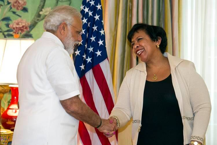 Attorney General Lorreta Lynch, right, and Prime Minister Narendra Modi shake hands during a ceremony marking the repatriation of over 200 artifacts to the Indian government, at Blair House in Washington, Monday, June 6, 2016. (AP Photo/Cliff Owen)