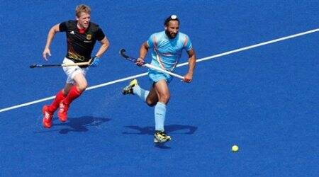 Germany's Timo Wess (L) challenges India's Sardar Singh during their men's Group B hockey match at the London 2012 Olympic Games at the Riverbank Arena on the Olympic Park August 3, 2012.         REUTERS/Suzanne Plunkett/File Photo