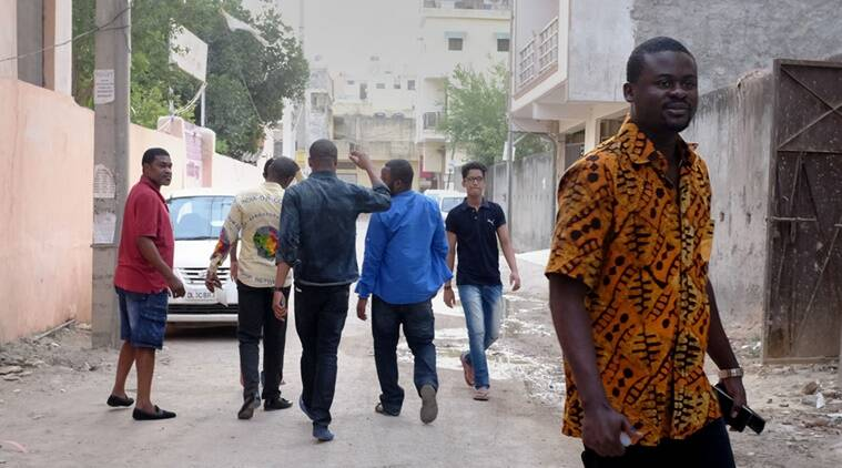 Strangers in a strange land: A group of Nigerian men in Chattarpur in south Delhi. (Express photo by Cheena Kapoor)