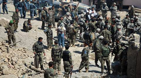 The Afghan National Army's 209th Corps commandos working with Afghan National Security Forces control the site of a Taliban-led suicide bomber attack on a U.S. contracting company office in Kunduz, Afghanistan on July 2, 2010.  Mohammad Jalal Naim/U.S. Army/Handout via REUTERS   ATTENTION EDITORS - THIS IMAGE WAS PROVIDED BY A THIRD PARTY. EDITORIAL USE ONLY