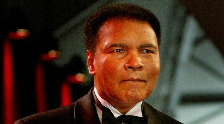 "File photo of former heavyweight boxing legend Muhammad Ali performing a magic trick during the ""Tribute to Bambi"" charity gala in northern Germany"
