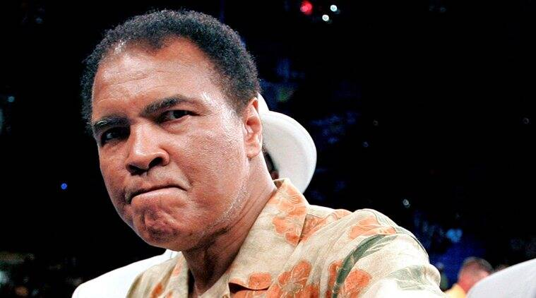 File photo of boxing great Muhammad Ali showing his fists as he stands in the ring after daughters fight in Washington